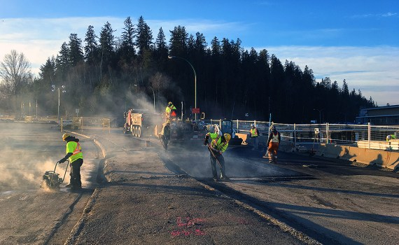 Crews were working on Tuesday to pave over the intersection of Queensway and Patricia Boulevard. They will also be working to install lighting and electrical work this week, prior to the intersection being reopened on Thursday. City of Prince George photo