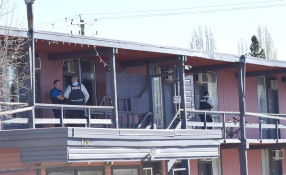 Police question possible witnesses of a shooting this morning at the Queensway Court Motel on Queensway near 17th Avenue. Bill Phillips photo