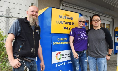 PG Recycling and Return-It Centre manager Ken Zeimer (left) and owner Austin Kim (right) with Team Norah organizer Sarah Schleich. Proceeds from recyclables donated at the centre's charity bins this month will go to Cystic Fibrosis Canada. Bill Phillips photo