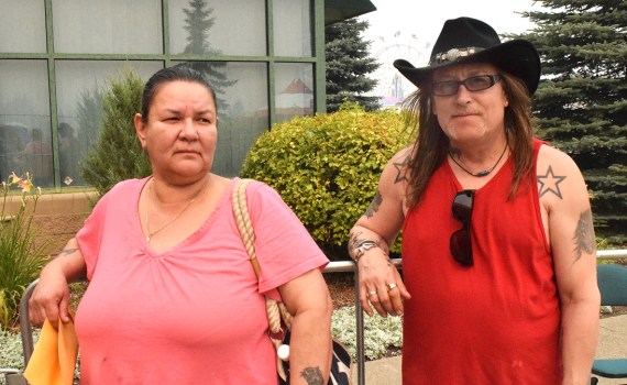 Fort St. James wildfire evacuees Leigh and Robert Embey wait in line to register at CN Centre. Bill Phillips photo
