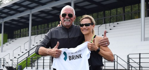 John Brink of the Brink Group and Jacqueline Pettersen give a thumb's up for the Berlin marathon.