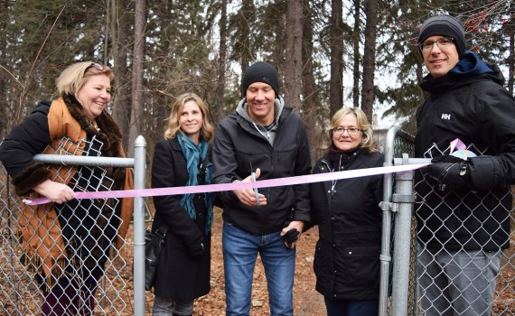 Frank Crosina cuts the ribbon to officially open Cedars Christian Trail in memory of his sister Jolene at Hospice House. Bill Phillips photo