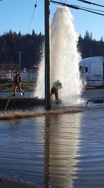 City employee Ryan Gallo battles a sheared-off fire hydrant. Ryan Lacasse Facebook photo