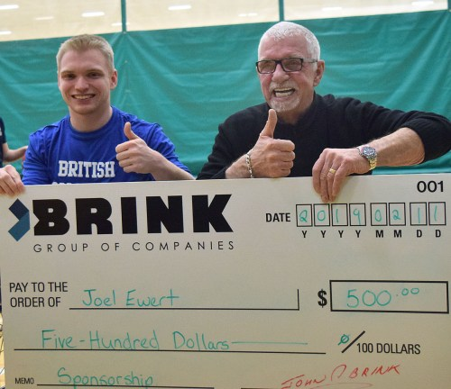 Brink Group of Companies founder and CEO John Brink, presents Joel Ewert with a cheque for $500 to help with his trip to the Canada Winter Games. Bill Phillips photo