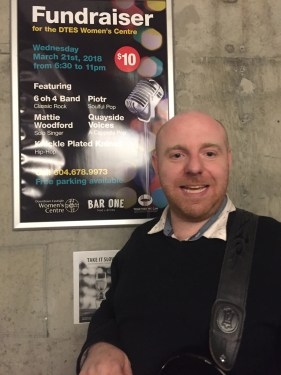 Matthew Woodford with the poster for a fundraiser he organized in the Downtown Eastside.