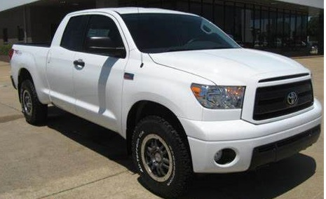 A white Toyota Tundra, similar to this one, was being driven by a man police want to question regarding attempts to lure children.