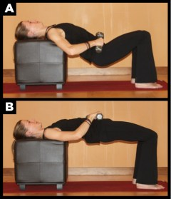 Woman showing how to do a hip thrust exercise.