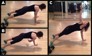 Woman exercising with the plank reach.