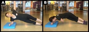 Woman working abs out with side plank.