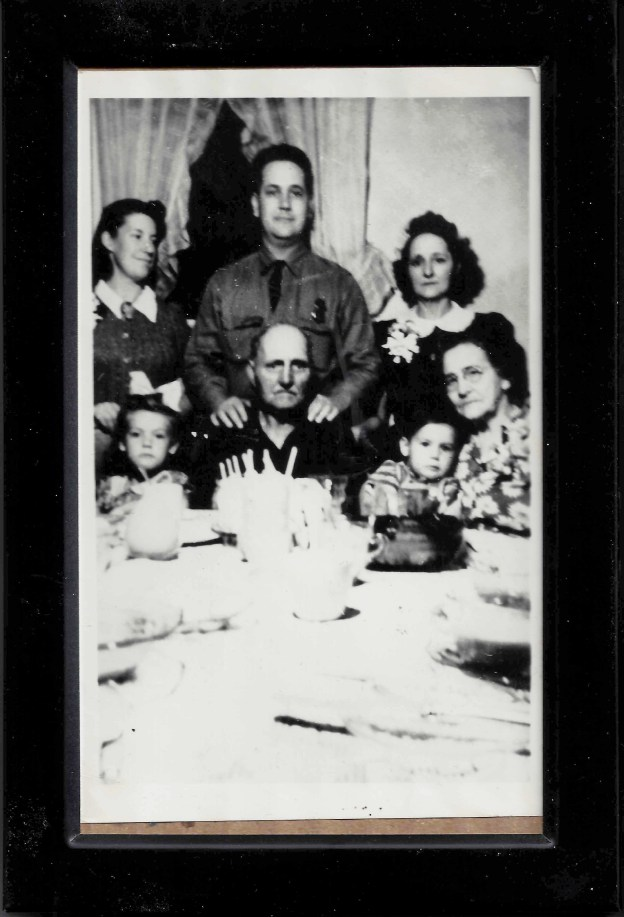 I think this must have been taken during WWII. That's Dad standing behind Grampa Thomas. Apparently this was a birthday for Grampa.