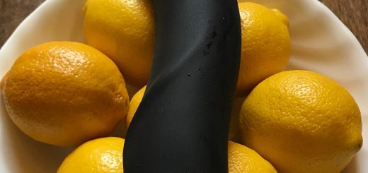 Fun Factory Boss dildo black on bowl of lemons