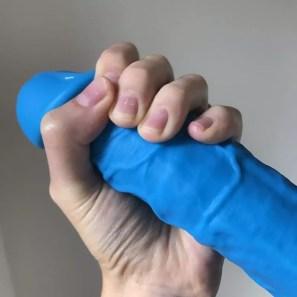 """ColourSoft 8"""" dildo blue, hand wrapped around it"""