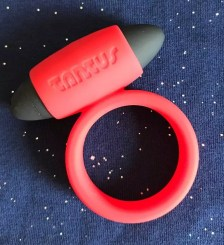 Tantus Vibrating Super Soft C-Ring red sparkly background