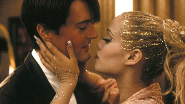 """Kyle McLaughlin and Berkley in an intimate moment after Nomi's first performance as the Goddess in """"Showgirls."""""""
