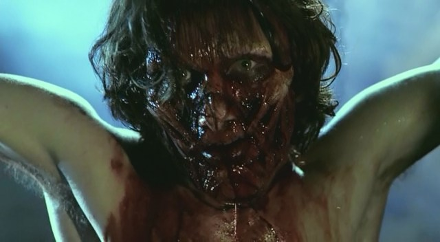 Actor Sebastien Roberts sporting a flayed face covered in blood.