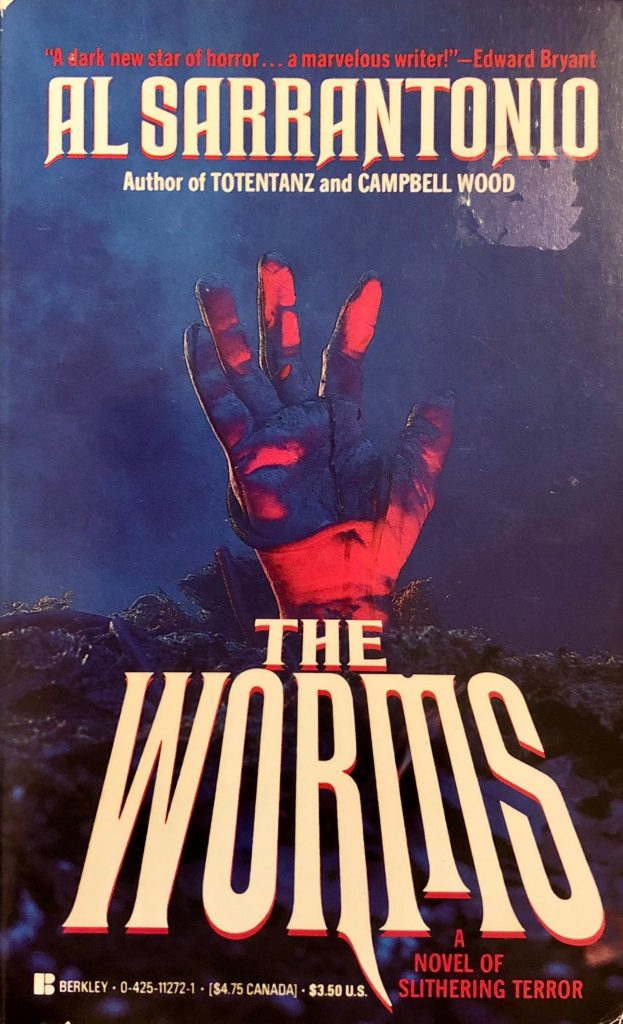 "Front cover of Al Sarrantonio's ""The Worms,"" featuring a hand shooting up from the earth, a worm slithering over the palm."