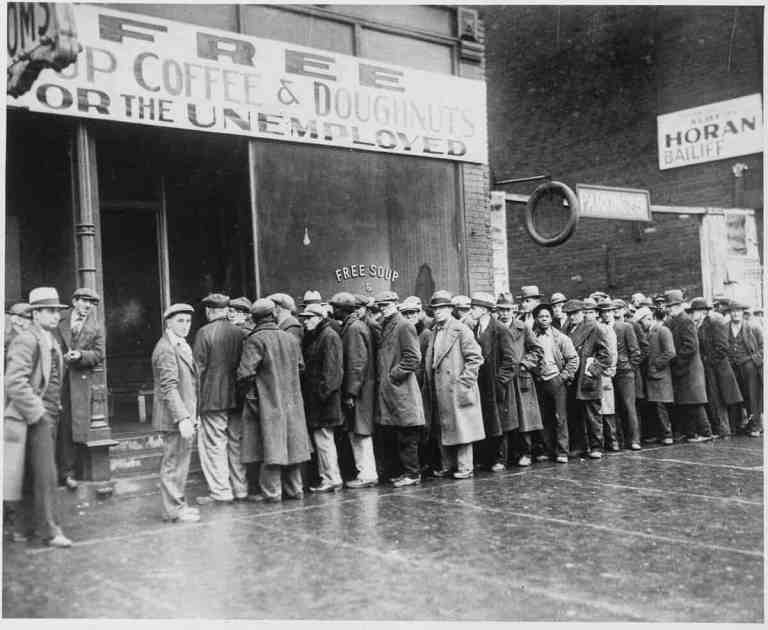2048px Unemployed men queued outside a depression soup kitchen opened in Chicago by Al Capone 02 1931   NARA   541927 2