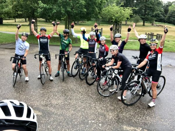 10 cyclists cheering at the end of a group ride
