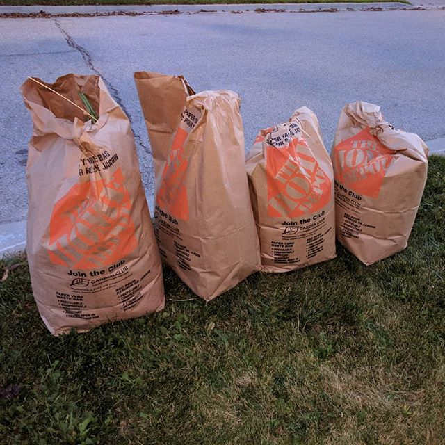 """For my Southern friends that think fall in Canada is """"so pretty"""". This is what it really looks like.. bags and bags of leaves!4 down... 40 to go?"""