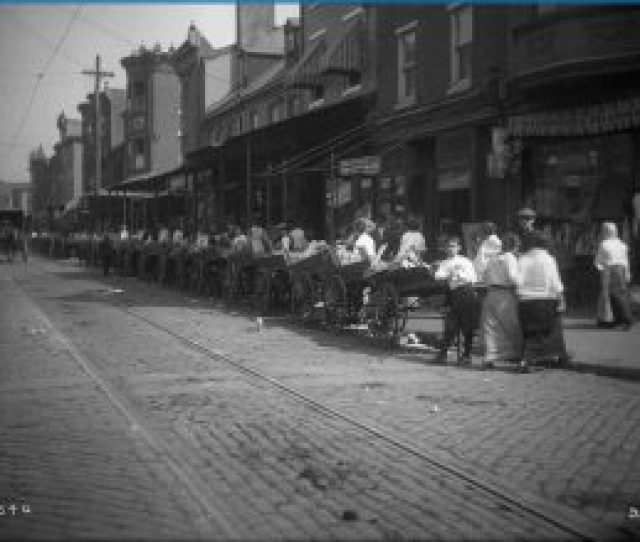 Before They Were Banned In The 1950s Many Immigrants Made A Living By Selling Dry Goods Out Of Pushcarts This 1914 Photo Shows A Line Of Pushcarts And