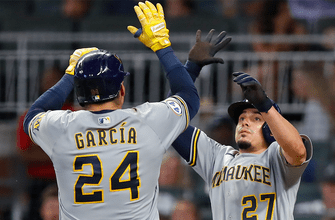 Brewers crush three homers in 9-5 win over Braves