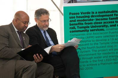 Philadelphia Mayor Michael Nutter and developer Jonathan Rose study their notes during the ribbon cutting ceremony.