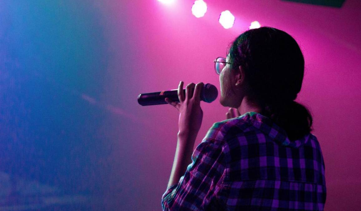 Girl holds a microphone