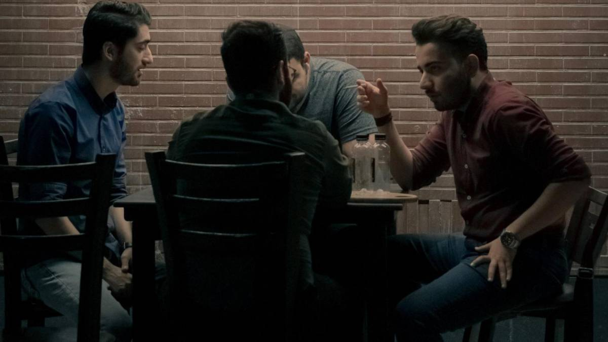Men gathered around a table talking