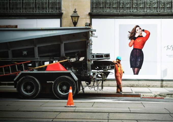 Construction worker standing near machine