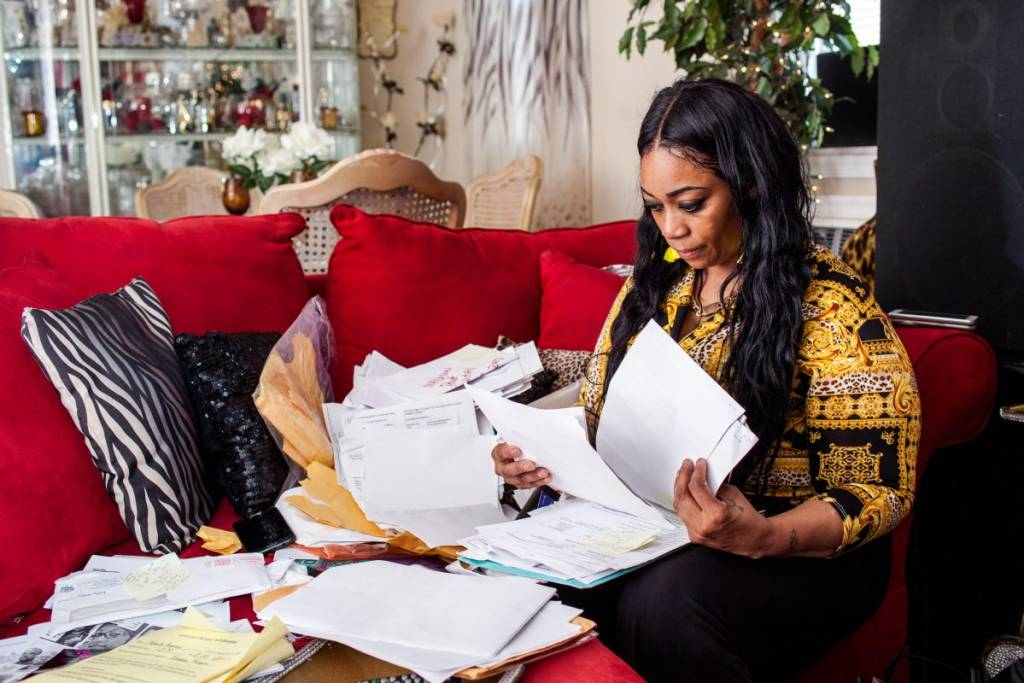 Yolanda Bryant sifts through her mail