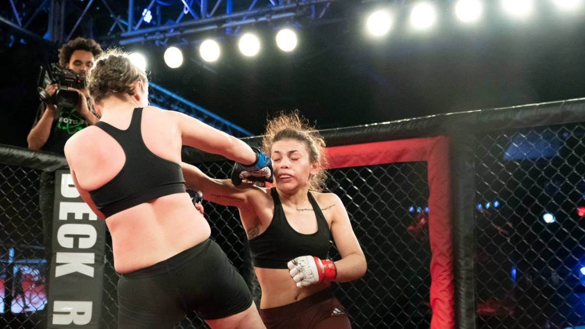 Two MMA fighters square off