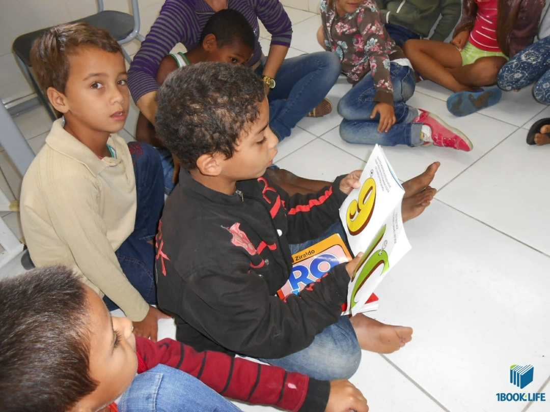 Boy reading with friends