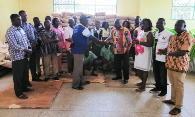 OKESS gets 120 bags of cement from 1991/93 alumni group
