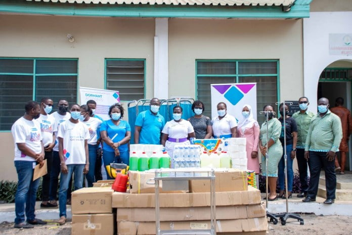 National Service Personnel at Republic Bank give Ashaiman Polyclinic equipment, supplies