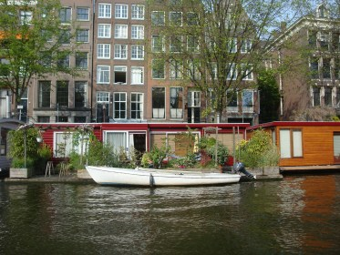 A house boat with its own boat