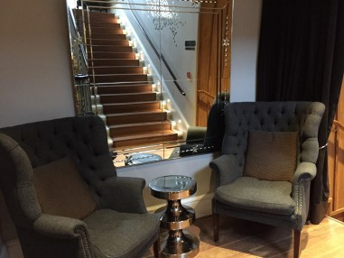 Private seating area across from stairs to the first floor Plum & Spilt Milk at the Great Northern Hotel London