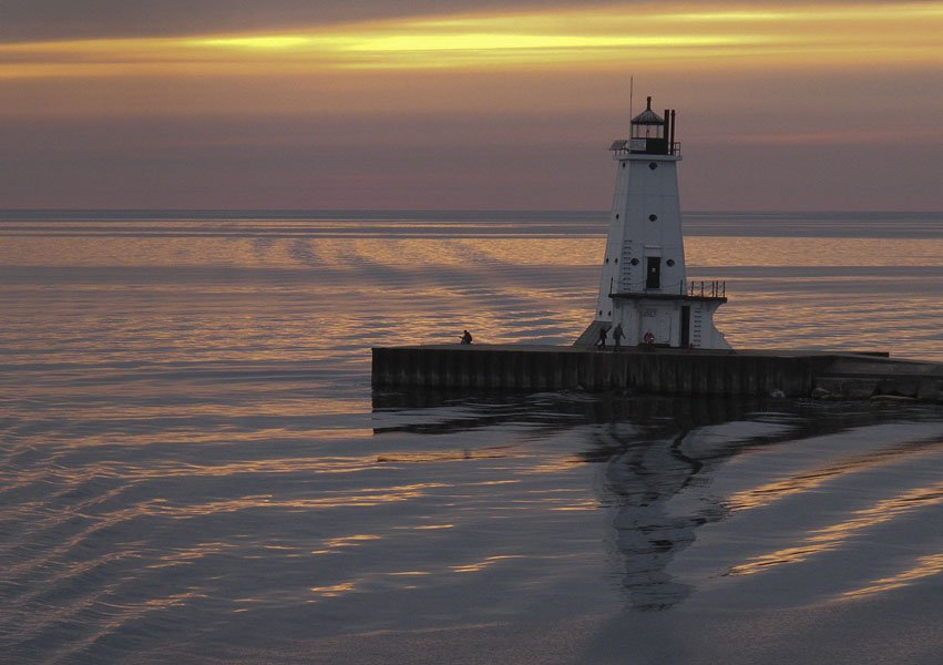 Passing the Ludington North Pierhead Lighthouse at sunset