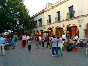 Restaurants on one side of the zocalo, under the arches. To the left is t