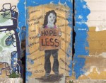 Graffiti image of person holding 'Hopeless' sign