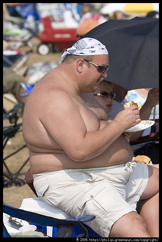 Fat dude eating junk.
