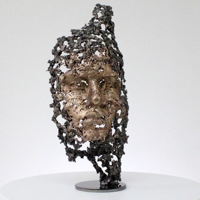 Sortir du bois sculpture visage metal acier bronze out of the woods face sculpture metal steel bronze philippe BUIL