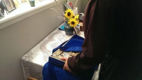 Father Jesse Philo prepares the icon for travel.