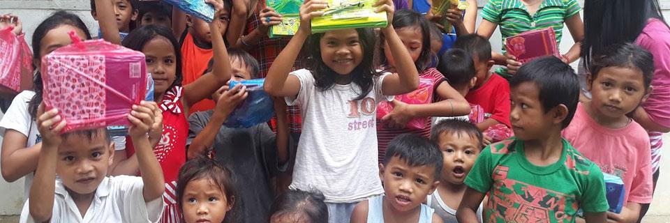 Kids with school supplies