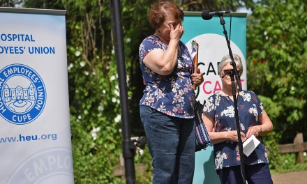 Raw emotion, tears at rally to support workers
