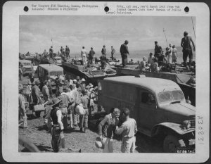 Newly liberated Los Banos internees being evacuated, February 1945