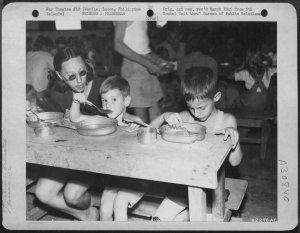 Bertha, Ronald and John Palmer after liberation, February 1945