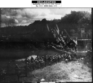 Invading Japanese troops crossing-river on Luzon, January 1942