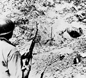 U.S. infantryman near the mouth of Malita Tunnel on Corregidor, 1945.jpg