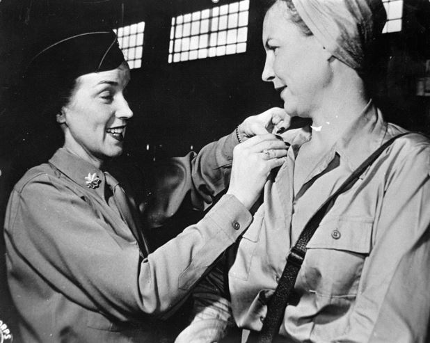 Lt. Rosemary Hogan gets new bars from Maj. Juanita Redmond.