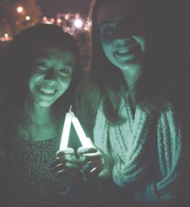 "Krystiana Swain '18, a board member of Active Minds, and Leeza Petrov '18 participated in the ""Walk into the Light"" Vigil, which commemorates Mental Illness Awareness Week."